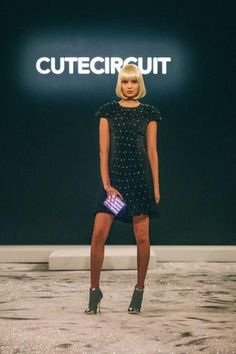 A LED dress controlled by a smartphone app by CuteCircuit NYFW 2014 - I like how it looks, but I think an autonomous sensing product is more interesting and suits are department better.