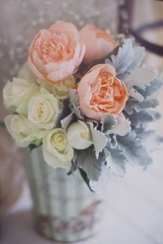 Peach david austins and white roses, dusty miller foliage. lovely simple table arrangement.