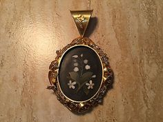 Victorian pique pansy pendant pique tortoiseshell inlaid with gold victorian pique pansy pendant pique tortoiseshell inlaid with gold and silver was developed in france and became popular in england in the late aloadofball Images
