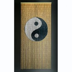 Yin and Yang is a 90 x 200cm beaded door curtain featuring the Yin& Yang symbol in black and white against a natural background.