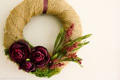 Cute! Great idea for spring!  wrapped in burlap with vibrant purple flowers on a background of moss.