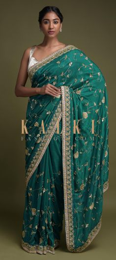 Buy Online from the link below. We ship worldwide (Free Shipping over US$100)  Click Anywhere to Tag Sea Green Saree In Cotton Silk With Zardozi Embroidered Floral Pattern Online - Kalki Fashion Sea green saree in cotton silk.Accentuated with sequins, cut dana and zardozi embroidered floral pattern.Paired with a matching unstitched blouse in raw silk with zardozi embroidered neckline