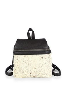 KARA's sleek Dyed Calf Hair & Leather Backpack is perfect to tote to class and beyond.