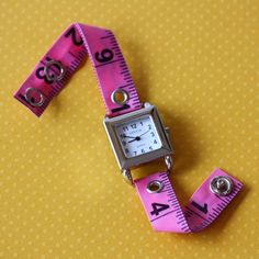 "HACKABLE JEWELRY :: Tape Measure Watch, Pink :: $20 | undoneclothing @ Etsy :: [7.5""-8"" l] Available in various colors :: Just like the tape measure bracelet, this is easily hacked w/ a tape measure & some snap closures & a cheap watch from K-mart or even the dollar store [where you can also pick up some cheap tape measure, while you're there]. Also a great gift idea! 