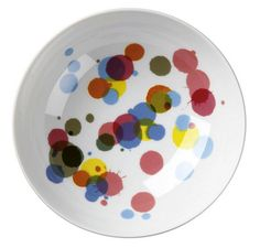 Hannah Werning's multi-hued ink dots dropped onto a Rörstrand bowl- maybe get a similar effect with majolica and stains?