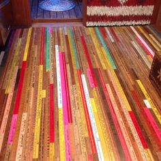 Reclaimed rulers as a floor in a tiny house-- too stinking cute! SCAD students designed 135 sq foot homes in a reclaimed multi-level parking garage. These are awesome.