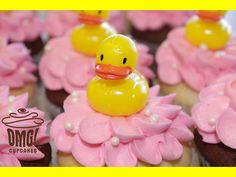 Pretty and pink rubber ducky cupcakes! Visit Omg! Cupcakes at	https://www.facebook.com/OmgCupcakesGP.