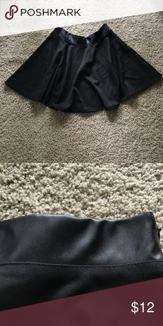 Black Skater Skirt Black skater skirt with pleather hip band. Super comfortable fit. Great condition. Size L but fits more like a M.  76% polyester 20% rayon 4% spandex Forever 21 Skirts Circle & Skater