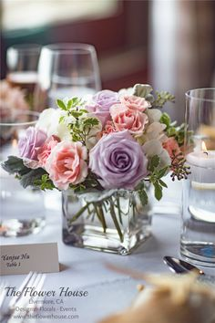 Reception centerpieces in lavenders, blush pinks, and whites by theflowerhouse.com
