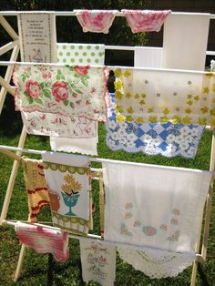 vintage linens on a drying rack...adorable!