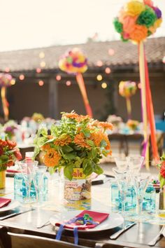 blue votives in bunches of three and four on the table at a fiesta themed rehearsal dinner.  www.boutiqueTHEO.com  Photo by Aaron Delesie  Design by Lisa Vorce
