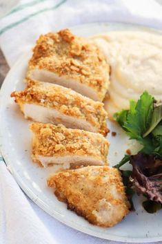 Ritz Chicken on a white plate with salad