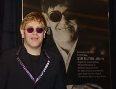 NEW YORK, UNITED STATES:  Singer and composer Elton John stands next to commemorative display marking his record-breaking performance 28 November, 2001, at Madison Square Garden in New York. John will perform his 53rd show at the Garden on 28 November, breaking the previous record of 52 performances held by the Grateful Dead since 1994. John's first concert was on 23 September, 1973.