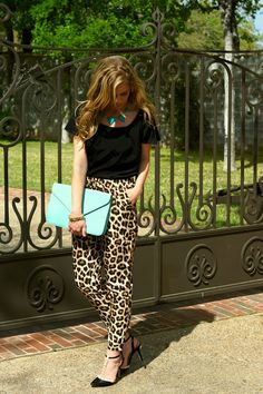 Ok.....so I am not daring enough to wear this....but I am a closet-lover of leopard print with black (and I like to throw in some hot pink) and I am LOVING the addition of turquoise!!!