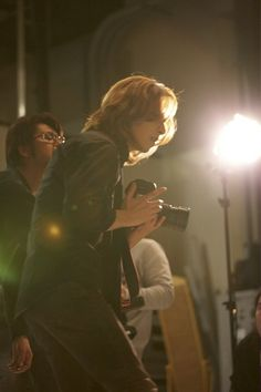 Yoshiki. I just love in the moment pictures, he's so cute :) He is music and light together.