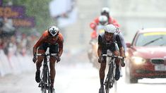 Marianne Vos of Netherlands (L) sprints and crosses the finish line ahead of Elizabeth Armitstead of Great Britain (R) to win the women's Cycling Road Race on Day 2.
