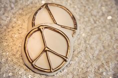 """Fun and glitzy peace sign cookies with tags that read """"Take a peace of our love with you."""" ~ gift as favors.    60's-Boho Glam Photo Shoot: Design & Coordination by beauandarrowevents.com, Photography by justinleephotography.com"""