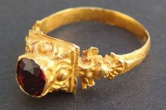 Decorative gold finger ring with intricate folate designs set with a large red stone. S Central Javanese Period 800 - 1000 A.D.