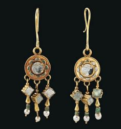 Pair of Byzantine gold, glass, and pearl earrings, dated to the 6th-7th centuries CE. Found on Christie's.