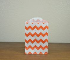 25 small ORANGE chevron paper gift or favor bags - 2.75 x 4 inches . $5.75, via Etsy.