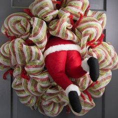 A large plush stuffed Christmas Santa bottom with legs. Red felt Santa coat trimmed with faux white fur trim. Two Santa legs with black boots and fur cuffs. Topped off with a black wire that can be used to attach this Santa bottom to a chimney, wreath, Ch Christmas Angel Decorations, Xmas Ornaments, Christmas Wreaths, Candy Wreath, Diy Wreath, Holiday Crochet, Diy Weihnachten, Deco Mesh Wreaths, Christmas Projects