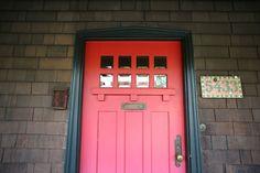 . The front door of a Craftsman bungalow built in 1911