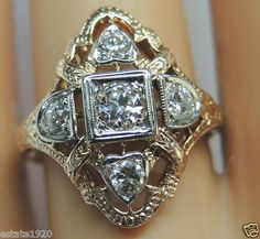 ANTIQUE ART DECO DIAMOND ENGAGEMENT RING CIRCA ~ 1930'S CENTER DIAMOND ~ ROUND BRILLIANT SIZE ~ .25CT COLOR ~ I - J CLARITY ~ VS 1 - VS 2 4 ROUND BRILLIANT CUT DIAMONDS ~ .40CT COLOR ~ H - I CLARITY ~ VS 1 - VS 2 TOTAL WEIGHT ~ .65CT METAL ~ 14KY & WHITE SOLID GOLD WEIGHT ~ 2.6 GRAMS FINGER SIZE ~ 6.25  (SIZABLE) U.S.A & CANADA