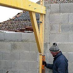 Régler la verticalité du poteau arrière.