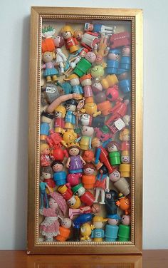 Plastic toys in a box frame Finally - a use for the box frame I bought from a charity shop two years ago thinking, 'that'll come in handy f...