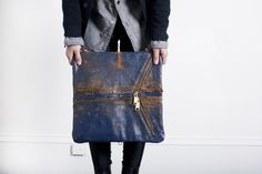 Limited-edition blue clutch made from 100-year-old English mailbags by Ampersand As Apostrophe #ecofashion