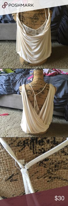 Rare Free people lace cream size small top Please note one strap will need to be resewn on, it's being held by a safety pin. Free People Tops Blouses