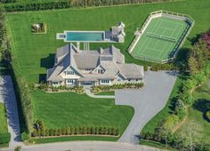 What more could you ask for? This aerial shot displays the beauty of this Hamptons home. Lush green grass, an enclosed tennis court, plenty of driveway space, swimming pool and hot tub, and of course an enchanting custom home!