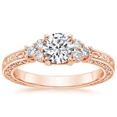 I'll take this one 14K Rose Gold Adorned Trio Diamond Ring from Brilliant Earth