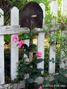 An old garden tool becomes a wonderful trellis in this cottage garden.