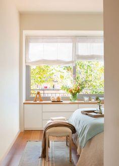 Una casa fresca de ventanas abiertas
