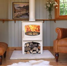 Including a choice of 8 colours, the Charnwood C-Five Stove comes fully customisable to meet every woodburner lover's needs. On offer in black! Log Store, Into The Woods, Wood Burner, Hearth, Home Projects, Property For Sale, Building A House, Family Room, Home Improvement