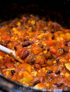 Easy Slow Cooker VEGGIE CHILLI: A variety of vegetables, a rich tomato base, and just the right amount of spice make this vegetarian chili especially delicious.