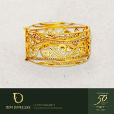 A golden 22 karat bangle in heritage style and designed with a contemporary twist. #DeviJewellers #Jewellery #Gold #Bangle #Chain #Pendant #Earrings #BeautyRedefined #jewelry #fashion #accessories #SriLanka #Gold #GoldJewellery #jewelrygram #instafollow #50YearsofTrust #instylesrilanka #uniquejewelry #lka #Design #Unique #ForHim #ForHer