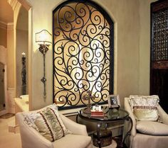 If you are having difficulty making a decision about a home decorating theme, tuscan style is a great home decorating idea. Many homeowners are attracted to the tuscan style because it combines sub… Mediterranean Living Rooms, Mediterranean Decor, Mediterranean Architecture, Mediterranean Bathroom, Wrought Iron Wall Decor, Rod Iron Decor, Wrought Iron Security Doors, Wrought Iron Gates, Iron Windows