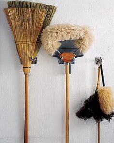 Hang your brooms and mops. I did this in my basement utility room and it freed up a lot of ground space. I wish my brooms and mops were as nice as the ones pictured, though! by jaime Cleaning Hacks, Cleaning Supplies, Organizing Tips, Cleaning Closet, Organising, Cleaning Cupboard, Cleaning Items, Le Terrier, Limpieza Natural