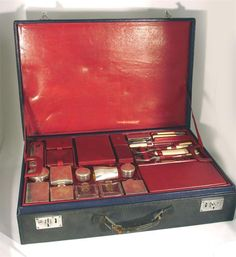 A large Hermes fully fitted gentleman's dressing case rectangular blue leather, the pull out tray fitted with various silver bottles, containers and a beaker and leather cases, with additional travelling cover stamped marks 65.5 x 45cm.