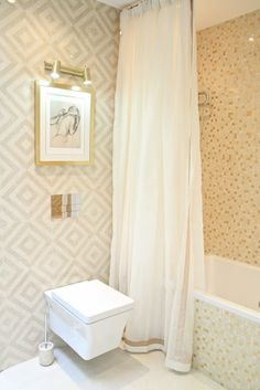 glamour bathroom with gold tiles mixed in with white.  White shower curtain is soft and simple with an elegant boarder in gold.