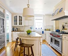 Tucked into the back corner of the house, this kitchen uses ever inch of space. By building the creamy-color cabinets around the appliances, the space feels finished and elegant.