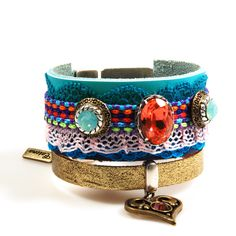 Ibiza leather cuff bracelet in boho style, wide colored bracelet Swarovski, heart charm, turquoise coral red, handmade jewelry by CatenaSieraden on Etsy https://www.etsy.com/listing/255498826/ibiza-leather-cuff-bracelet-in-boho