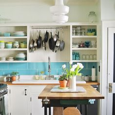 A new splash of color, a few creative projects, and better organization wake up this budget kitchen