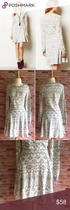 "Anthropologie Dolce Vita Faroese dress Dolce Vita combines of-the-moment trends with modern staples to form an assortment of covetable shoes, accessories and apparel. Inspired by Southern California trendsetters, each seasonal collection is comprised of contemporary must-haves guaranteed to keep you on-trend. Long sleeve textured burnout dress. Lined skirt. In excellent condition. 64/36 cotton, poly. 38""L. 18.5"" bust laying flat. Size medium. Anthropologie Dresses"