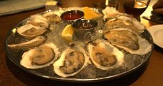 Lineage - Coolidge Corner, Brookline - for fresh oyster deals ($1 oysters every night from 5 to 7 pm) and cocktails.