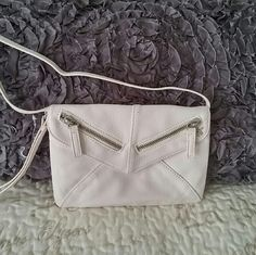 """Aeropostale Crossbody/Wristlet Off white bag with zipper detail can be worn as a crossbody using detachable appx. 23"""" strap. Or use as a wristlet. Measures 8""""w x 5.5""""h. Zippers are functional but for design only, there is no pocket to use as storage. Never been used but tag was partially removed. Aeropostale Bags Clutches & Wristlets"""