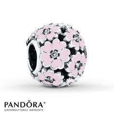 Primrose flowers with pink enamel petals and clear cubic zirconia centers bloom in this sterling silver charm from the PANDORA Spring 2015 collection. Style # 791488EN68.