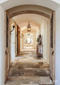 Atop a hill with commanding views, an expansive abode brings an authentic touch of France, with a dash of contemporary spirit, to an Irvine community.